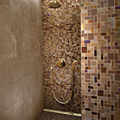 Large walk-in shower with brown and beige mosaic on the wall with various sizes of square and rectangular tile.