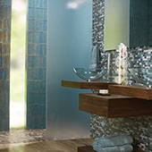 Modern bathroom feature wall with blue glass one by two inch mosaic tile.
