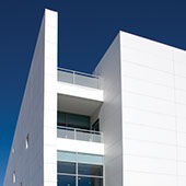 Exterior view of a commercial building covered with large format white porcelain cladding.