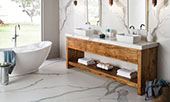 Marble-look extra-large Panoramic Porcelain Surfaces tile on the walls and floor of an upscale bathroom.